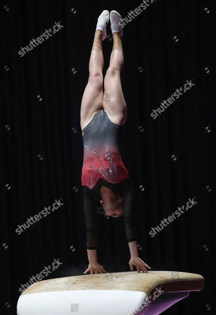 Stock Image of Hong Kong's Elizabeth Chan competes on the vault during the women's all-around gymnastics competition at the 18th Asian Games in Jakarta, Indonesia
