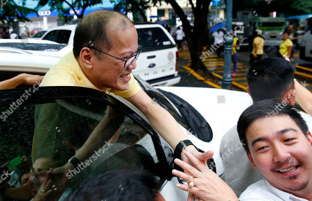 """Former President Benigno Aquino III agrees for a selfie with a supporter following a mass in commemoration of the Aug. 21, 1983 Manila International Airport assassination of Aquino III's father, opposition Senator Benigno Aquino Jr. at Sto. Domingo church in suburban Quezon city north of Manila, Philippines . Aquino Jr.'s assassination sparked series of protests that eventually toppled the late dictator Ferdinand Marcos from 20-year-rule and helped install his widow Corazon """"Cory"""" Aquino to the presidency via People Power revolt"""