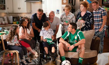 Stock Photo of Ep 9550 Monday 3 September 2018 - 1st Ep  Kevin Webster, as played by Michael Le Vell, brings Jack Webster, as played by Kyran Bowes, home in his wheelchair. As everybody makes a fuss of him, Jack's underwhelmed and Fiz worries they've misjudged his mood. Tommy Orpington, as played by Matt Milburn, makes an entrance in his full County kit at Jack's party. All the kids flock to him but Jack's tired and heads to bed. The party breaks up. With Fiz Stape, as played by Jennie McAlpine, Sally Metcalfe, as played by Sally Dynevor, Tim Metcalfe, as played by Joe Duttine, Tyrone Dobbs, as played by Alan Halsall.