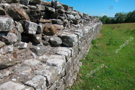 This photo shows a section of Hadrian's Wall, near Birdoswald Fort, Cumbria in northern England. When completed, around 128 AD, it stood up to 4.6 meters (15 feet) and was three meters (9.8 feet) wide. It ran for 118 kilometers (73 miles) and bristled with forts, watchtowers and guard posts. It was built by the Romans to control movement across the frontier and to stop warlike tribes raiding their territory. Large sections of the wall still remain