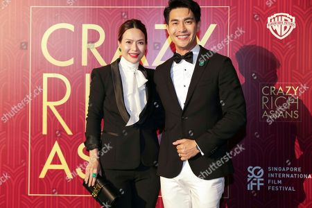 """Pierre Png, Andrea De Cruz. Actor Pierre Png and his wife Andrea De Cruz pose for photographers as they arrive for the red carpet screening of the movie """"Crazy Rich Asians"""", in Singapore"""