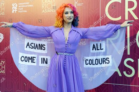 """Stock Image of Burlesque performer Sukki Singapora poses for photographers as she arrives for the red carpet screening of the movie """"Crazy Rich Asians"""", in Singapore"""
