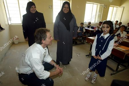 Editorial photo of Prime Minister Tony Blair Has Twinkle Twinkle Little Star Sung To Him At The Khadija Alkobra Girls School In The Southern Iraq Town Of Basra During His Visit. See Ross Benson Story.