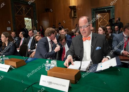 Assistant Secretary for International Security and Nonproliferation at the State Department Christopher Ford prepares to testify as the Senate Banking Committee holds a hearing on U.S. economic sanctions against Russia and whether the actions are effective, on Capitol Hill in Washington