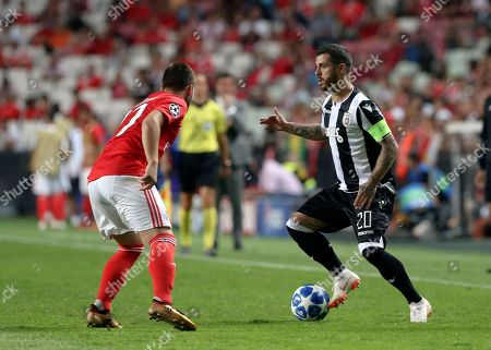 PAOK's Vieirinha, right, challenges for the ball with Benfica's Andrija Zivkovic during the Champions League playoffs, first leg, soccer match between Benfica and PAOK at the Luz stadium in Lisbon