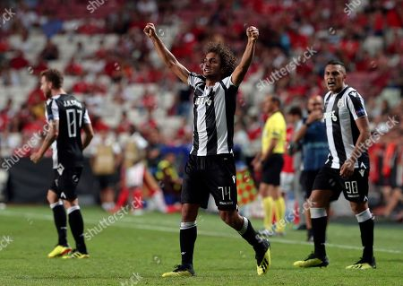 PAOK's Amr Warda, center, celebrates scoring his side's first goal during the Champions League playoffs, first leg, soccer match between Benfica and PAOK at the Luz stadium in Lisbon