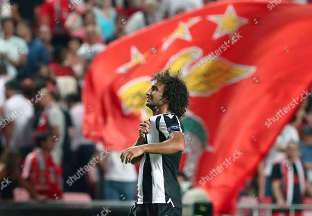 PAOK's Amr Warda salutes fans at the end of the Champions League playoffs, first leg, soccer match between Benfica and PAOK at the Luz stadium in Lisbon