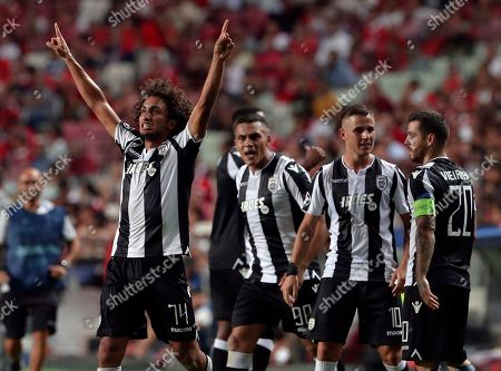 PAOK's Amr Warda celebrates scoring his side's first goal during the Champions League playoffs, first leg, soccer match between Benfica and PAOK at the Luz stadium in Lisbon