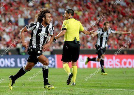 PAOK's Amr Warda, left, celebrates scoring his side's first goal during the Champions League playoffs, first leg, soccer match between Benfica and PAOK at the Luz stadium in Lisbon
