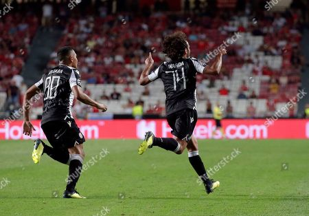 PAOK's Amr Warda, right, celebrates scoring his side's first goal during the Champions League playoffs, first leg, soccer match between Benfica and PAOK at the Luz stadium in Lisbon