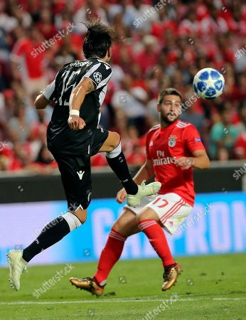 PAOK's Jose Angel Crespo, left, kicks the ball next to Benfica's Andrija Zivkovic during the Champions League playoffs, first leg, soccer match between Benfica and PAOK at the Luz stadium in Lisbon