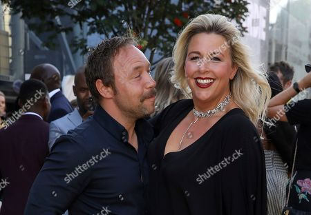 Stephen Graham, Hannah Walters. Actor Stephen Graham, left, and partner Hannah Walters pose for photographers on arrival at the premiere of the film 'Yardie', in London