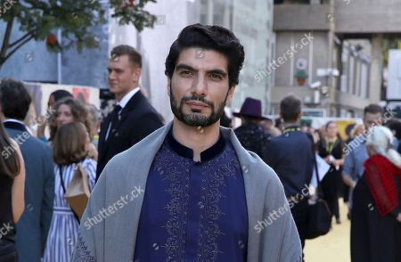 Stock Photo of Akin Gazi poses for photographers on arrival at the premiere of the film 'Yardie', in London