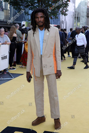 Stock Picture of Actor Sheldon Shepherd poses for photographers on arrival at the premiere of the film 'Yardie', in London