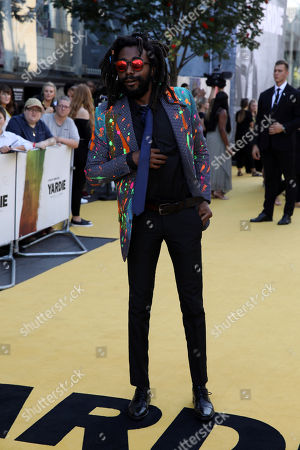 Stock Image of Everaldo Creary poses for photographers on arrival at the premiere of the film 'Yardie', in London