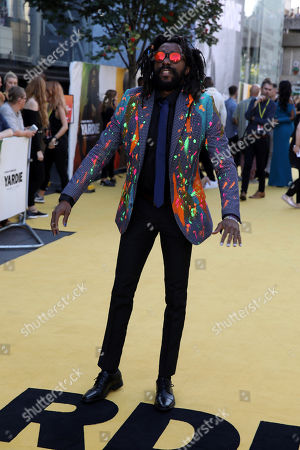 Everaldo Creary poses for photographers on arrival at the premiere of the film 'Yardie', in London