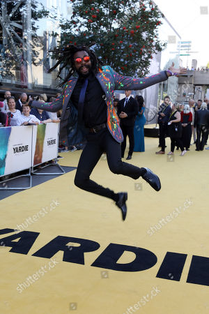 Stock Photo of Everaldo Creary poses for photographers on arrival at the premiere of the film 'Yardie', in London