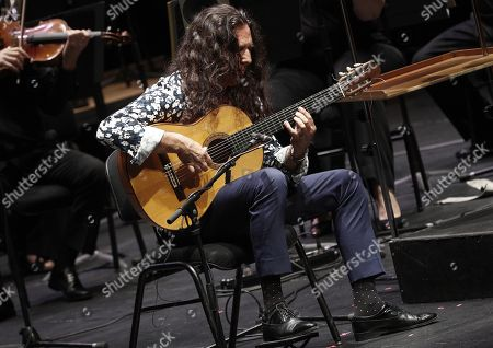Stock Image of Spanish guitar player Jose Fernandez Torres 'Tomatito' performs with the Symphonic Orchestra of Navarra at the Baluarte Congress Palace in Pamplona, northern Spain, 24 August 2018, in the context of the Flamenco On Fire Festival, running from 21 until 26 August 2018.