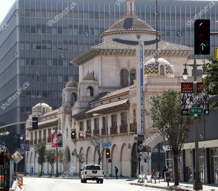 The ornate former headquarters of the defunct Los Angeles Herald Examiner is seen on South Broadway in downtown Los Angeles . The building will be renovated for an expansion of Arizona State University, the school announced Tuesday. It plans to lease the century-old building in a part of downtown L.A. undergoing a sweeping resurgence. The university says the Walter Cronkite School of Journalism and Mass Communications and Herberger Institute for Design and the Arts will hold classes at the building, which ASU expects to occupy in 2020