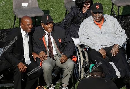 Former San Francisco Giants players Barry Bonds, from left, Willie Mays and Willie McCovey are shown at a ceremony to retire Bonds' number before a baseball game between the Giants and the Pittsburgh Pirates in San Francisco