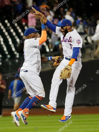 New York Mets' Jose Reyes, left, celebrates with teammate Amed Rosario after a baseball game against the San Francisco Giants, in New York. The Mets won 6-3