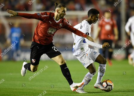 Rodrygo of Brazil's Santos, right, fights for the ball with Gaston Silva, left, of Argentina's Independiente, during a Copa Libertadores soccer match in Buenos Aires, Argentina