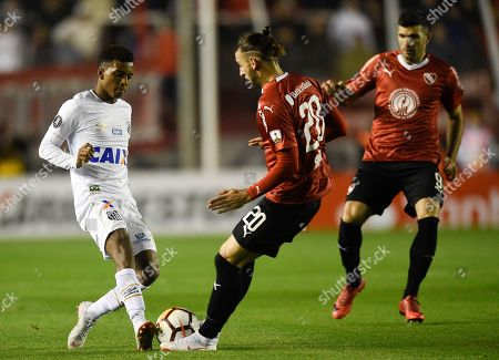 Rodrygo of Brazil's Santos, left, fights for the ball with Gaston Silva of Argentina's Independiente during a Copa Libertadores soccer match in Buenos Aires, Argentina