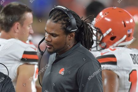 Cleveland Browns special teams coaching intern Josh Cribbs stands on the sideline during an NFL football preseason game against the Buffalo Bills, in Cleveland. Buffalo won 19-17