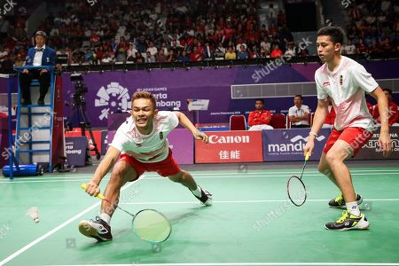 Fajar Alfian (L) and Muhammad Rian Ardianto (R) of Indonesia in action against Cheng Liu and Nan Zhang of China during the men's Badminton team final between China and Indonesia at the 18th Asian Games in Jakarta, Indonesia, 22 August 2018.