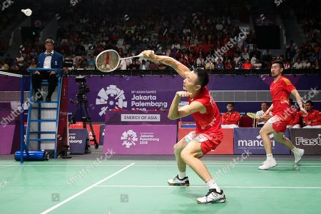 Stock Picture of Nan Zhang (L) and Cheng Liu (R) of China in action against Fajar Alfian and Muhammad Rian Ardianto of Indonesia during the men's Badminton team final between China and Indonesia at the 18th Asian Games in Jakarta, Indonesia, 22 August 2018.