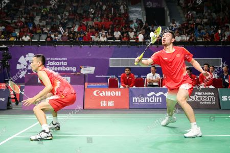 Cheng Liu (R) and Nan Zhang (L) of China in action against Fajar Alfian and Muhammad Rian Ardianto of Indonesia during the men's Badminton team final between China and Indonesia at the 18th Asian Games in Jakarta, Indonesia, 22 August 2018.