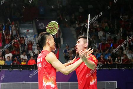 Stock Photo of Nan Zhang (L) and Cheng Liu (R) of China celebrate after beating Fajar Alfian and Muhammad Rian Ardianto of Indonesia during the men's Badminton team final between China and Indonesia at the 18th Asian Games in Jakarta, Indonesia, 22 August 2018.