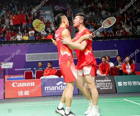 Nan Zhang (L) and Cheng Liu (R) of China celebrate after beating Fajar Alfian and Muhammad Rian Ardianto of Indonesia during the men's Badminton team final between China and Indonesia at the 18th Asian Games in Jakarta, Indonesia, 22 August 2018.
