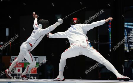Koki Kano, Chao Dong. Japan's Koki Kano, left, competes against China's Chao Dong, during their men's epee team finals fencing match at the 18th Asian Games in Jakarta, Indonesia