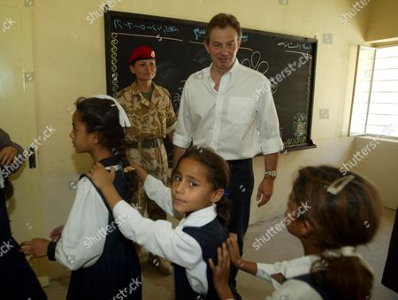 Stock Picture of Prime Minister Tony Blair Meets Children At The Khadija Alkobra Girls School In The Southern Iraq Town Of Basra During His Visit. See Ross Benson Story.