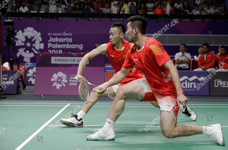 China's Liu Cheng and Nan Zhang during the men's team badminton against Indonesia at the 18th Asian Games in Jakarta, Indonesia
