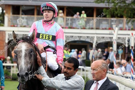 PHEONIX OF SPAIN (4) ridden by jockey Jamie Spencer and trained by Charles Hills enter the Winners Enclosure after winning The Group 3 Tattersalls Acomb Stakes over 7f (£100,000) during the Yorkshire Ebor Festival at York Racecourse, York. Picture by Mick Atkins