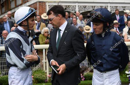 Trainer Aidan O'Brien talks to jockeys Wayne Lordan and Michael Hussey