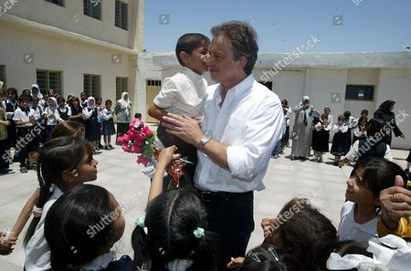 Stock Image of Prime Minister Tony Blair Receives A Peck On The Cheek From 6 Year Old Abbas Adnan At Khadija Alkobra Girls School In The Southern Iraq Town Of Basra During His Visit. See Ross Benson Story.