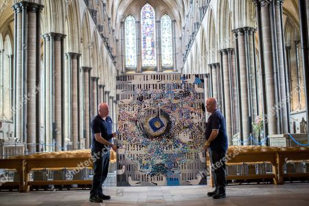 Salisbury Cathedral Caretakers Steve and Tony Marshall as they  move The Miracle of Song 2014 into place.