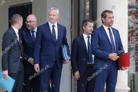 From left, From left, French Junior Minister for Public Administration Olivier Dussopt, French Agriculture Minister Stephane Travert, French Finance Minister Bruno Le Maire, French Budget Minister Gerald Darmanin and eputy minister in charge of the relations with the Parliament Christophe Castaner leave the Cabinet meeting at the Elysee Palace in Paris, France, . French President Emmanuel Macron is back from summer vacation and he plans to launch a new push for economic changes as he faces growing criticism at home