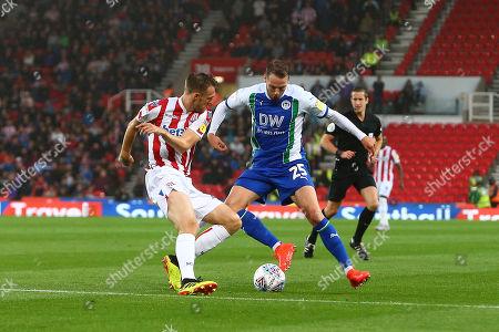 Stoke's Darren Fletcher and Wigan's Nick Powell