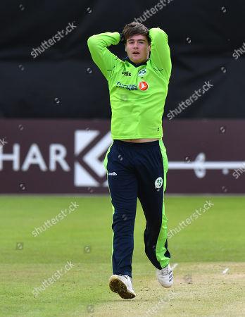 Ireland vs Afghanistan. Ireland's Josh Little dejected after missing the stumps