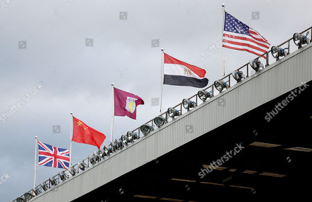 Stock Photo of Egypt and USA flags are seen flying above Villa park in representation of new owners majority owners Nassef Sawiris and Wes Edens.