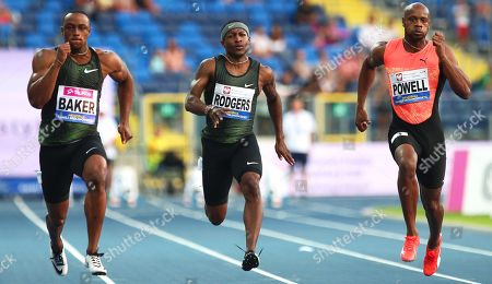 Ronnie Baker (L), Mike Rodgers (C), both of the USA, and Asafa Powell (R) of Jamaica compete during the men's 100m race of the 9th Kamila Skolimowska Memorial athletics meeting in Chorzow, Poland, 22 August 2018.