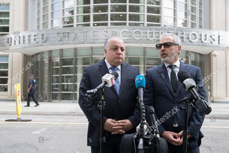 Paulo Peixoto, Julio Barbosa. Attorneys Paulo Peixoto, left, and Julio Barbosa speak to reporters outside Brooklyn federal court, in New York. Their client, Jose Maria Marin, a former South American soccer official, has been sentenced to four years in prison for his conviction on corruption charges in the sprawling FIFA bribery scandal
