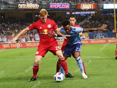 Tim Parker, Rodney Wallace. New York Red Bulls defender Tim Parker, left, keeps the ball away from NYCFC midfielder Rodney Wallace during the second half of an MLS soccer match, in New York. The match ended in a 1-1 draw
