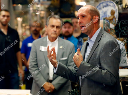 Republican candidate Steve Ferrara speaks to supporters at an antique store in Phoenix. The three-way Republican primary in Arizona's 9th Congressional District will determine which candidate will try to flip a Democratic district full of independent voters