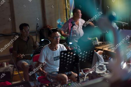Chiu Chow opera musicians play during a performance in the New Territories in Hong Kong, China, 22 August 2018 (issued 23 August 2018). Around 1.2 million people originating from Chiu Chow (Chaozhou) in China's Guangdong province live in Hong Kong. During the Hungry Ghost Festival, they organise their own Yu Lan Ghost Festival, which includes opera performances for ghosts in need of a bit of entertaining. While the festival's origins are not unlike those of Halloween in Europe, it is also intrinsically linked to the Chinese practice of ancestor worship.
