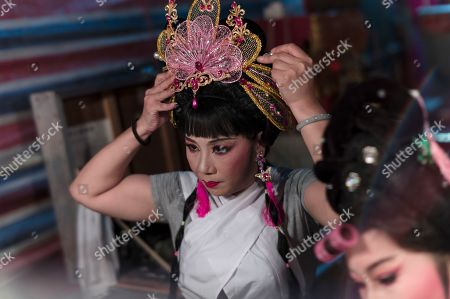 A Chiu Chow opera performer makes up in the backstage during a performance in the New Territories in Hong Kong, China, 22 August 2018 (issued 23 August 2018). Around 1.2 million people originating from Chiu Chow (Chaozhou) in China's Guangdong province live in Hong Kong. During the Hungry Ghost Festival, they organise their own Yu Lan Ghost Festival, which includes opera performances for ghosts in need of a bit of entertaining. While the festival's origins are not unlike those of Halloween in Europe, it is also intrinsically linked to the Chinese practice of ancestor worship.